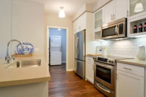 Kitchen with stainless steel appliances and laundry room